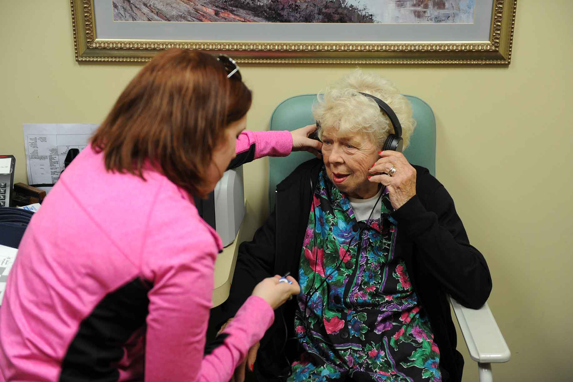 Nurse Assisting Woman with Headphones